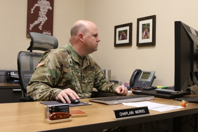 Chaplain Morris works at his desk at Joint Force Headquarters, in Jackson, Miss., on March 10, 2017. Morris is the first full-time support chaplain for the Mississippi Army National Guard.