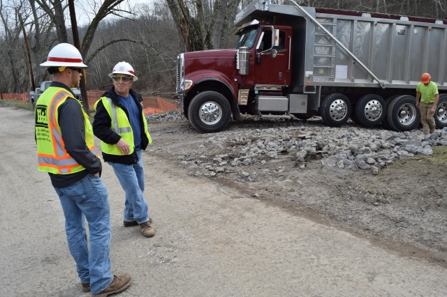 Matt McKissick, project engineer, and Bob Tramontina, construction control representative, oversee the more than $880,000 shoreline reclamation project in Worthington, West Virginia. The project is designed to protect a sanitary sewer line that runs along the West Fork River bank.