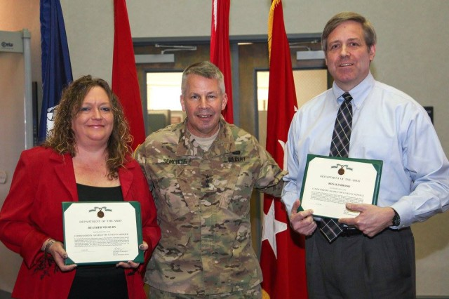 : During his recent visit to Huntsville Center Feb. 16, U.S. Army Corps of Engineers Commander Lt. Gen. Todd Semonite presented Commander's Awards for Civilian Service to Access Control Point Program's Heather Wilburn and Ron Brook on behalf of Col. Eugenia Guilmartin, Fort Bragg's director of emergency services. The awards were for exceptionally meritorious achievement in support of access control point projects there.