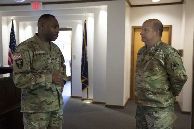 U.S. Army Maj. Gen. Robert E. Livingston, Jr., Adjutant General of South Carolina, and U.S. Army Col. David Jenkins, 228th Theater Tactical Signal Brigade (TTSB) commander, talk before an engagement with U.S. Army Col. Jeff Worthington, 2nd Signal Brigade commander, and U.S. Army Command Sgt. Maj. Gregory D. Rowland, 2nd Signal Brigade Command Sgt. Maj., at the McCrady Training Center in Eastover, South Carolina, March 11, 2017, to discuss sustainable readiness while their units look ahead to partner during future operations. The gathering was held during a scheduled training event for the 228th TTSB.