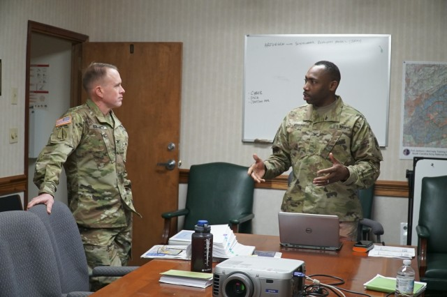 U.S. Army Col. Jeff Worthington, 2nd Signal Brigade commander, speaks with U.S. Army Col. David Jenkins, 228th Theater Tactical Signal Brigade (TTSB) commander, during an engagement at the McCrady Training Center in Eastover, South Carolina, March 12, 2017, to discuss sustainable readiness while their units look ahead to partner during future operations. The gathering was held during a scheduled training event for the 228th TTSB.