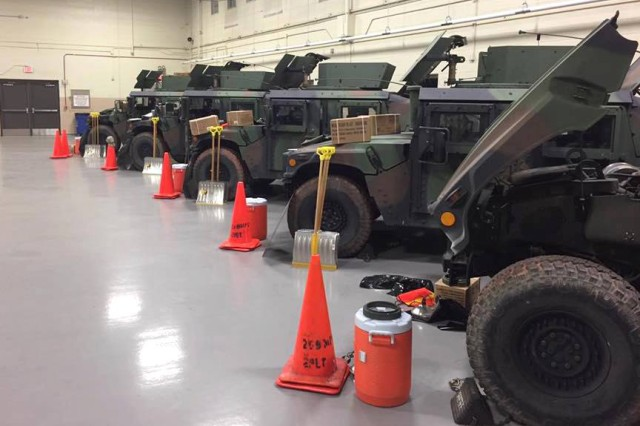 Virginia National Guard Soldiers assigned to the Manassas-based 266th Military Police Company, 1030th Transportation Battalion, 329th Regional Support Group line up vehicles for possible snow response operations March 13, 2017, in Manassas, Virginia.