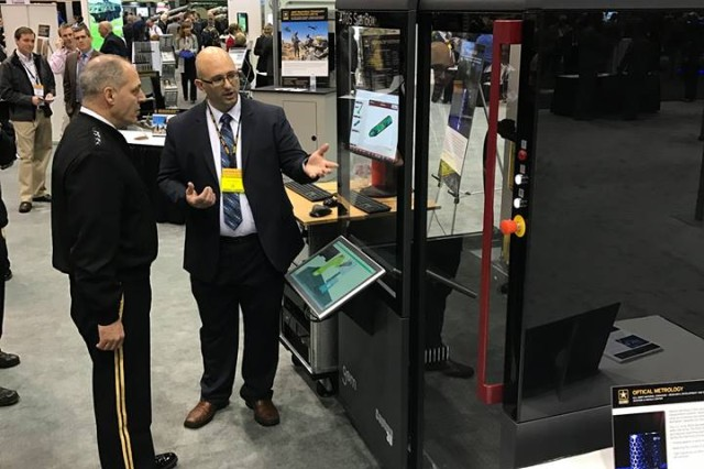 Ben Thomason, AMRDEC Metrology, discusses Optical Metrology uses within the Army with Army Materiel Command's Commanding General, Gen. Gus Perna at AUSA.