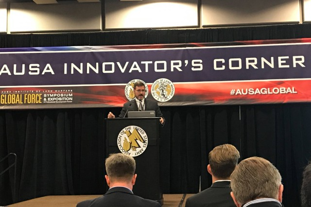 AMRDEC's Layne Merritt presents about Degraded Visual Environment Mitigation at AUSA's Innovator's Corner.