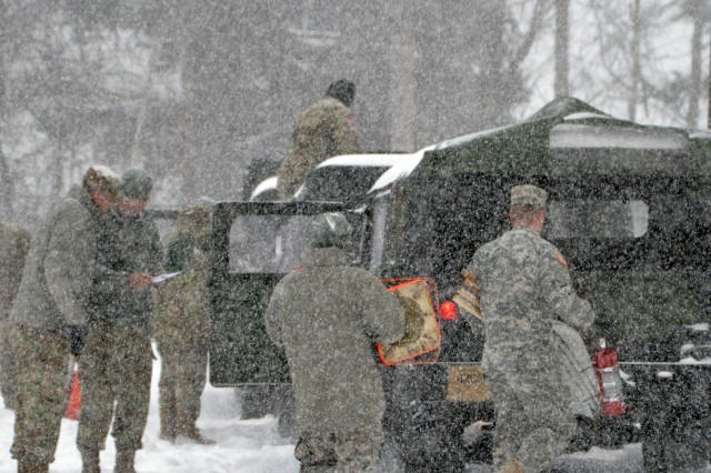 New York Army National Guard Soldiers from the 42nd Combat Aviation Brigade based in Latham prepare their Humvees for missions as a massive snow storm hits New York March 14, 2017. The Soldiers are prepared to provide mobility support or traffic control help to local authorities.