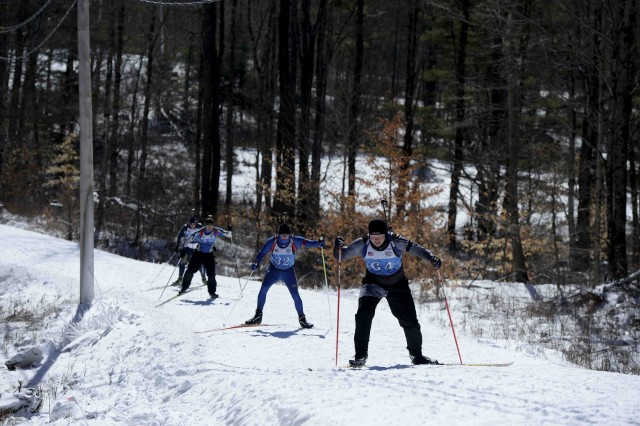 Soldiers race up a hill during the 2017 Chief National Guard Bureau Biathlon Championship held at Camp Ethan Allen Training Site, Jericho, Vt., March 5, 2017.  Approximately 120 athletes from 23 different states participated in the annual competition.