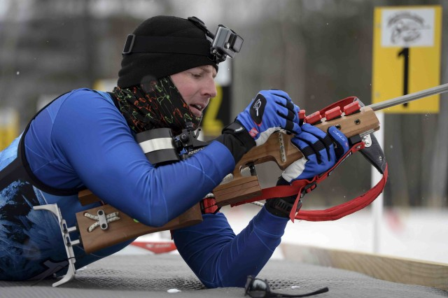 A Soldier from South Dakota reloads his rifle during the 2017 Chief National Guard Bureau Biathlon Championship held in Camp Ethan Allen Training Site, Jericho, Vt., March 5, 2017.  Approximately 120 athletes from 23 different states participated in the annual competition.