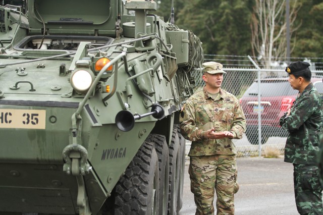 Sgt. 1st Class Derik Kearns, a Reno, Nevada native who serves as a lead instructor at the Bayonet Academy's Stryker Leader Transition Course on JBLM, provides an overview of the Stryker vehicle platform to Royal Thai Army Lt. Gen. Apirat Kongsompong, First Army Area commander in Thailand, March 8.