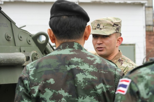 Sgt. 1st Class Derik Kearns, a Reno, Nevada native who serves as a lead instructor at the Bayonet Academy's Stryker Leader Transition Course on JBLM, provides an overview of the Stryker vehicle platform to a military delegation from the Royal Thai Army, March 8.