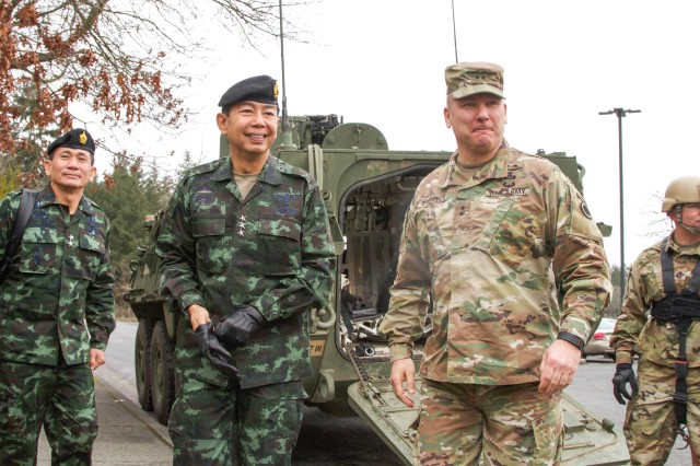 Maj. Gen. Mark Stammer (right), I Corps deputy commanding general, greets Royal Thai Army Lt. Gen. Apirat Kongsompong, First Army Area commander in Thailand, after a ride in a Stryker vehicle, March 8 at Joint Base Lewis-McChord, Washington. Apirat was visiting to learn more about the Stryker vehicle platform that is frequently used by Soldiers from the installation. I Corps is regionally aligned to the Pacific and works with a number of nations, to include Thailand, every year in efforts to build security cooperation throughout the region.