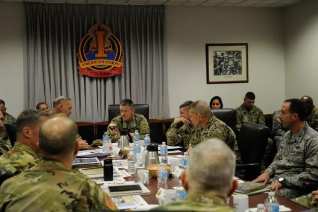 Lt. Gen. Stephen R. Lanza, middle left, I Corps commanding general, speaks to Gen. Daniel B. Allyn, middle, vice chief of staff of the Army, about the programs within the Ready and Resiliency Campaign Joint Base Lewis-McChord last November.
