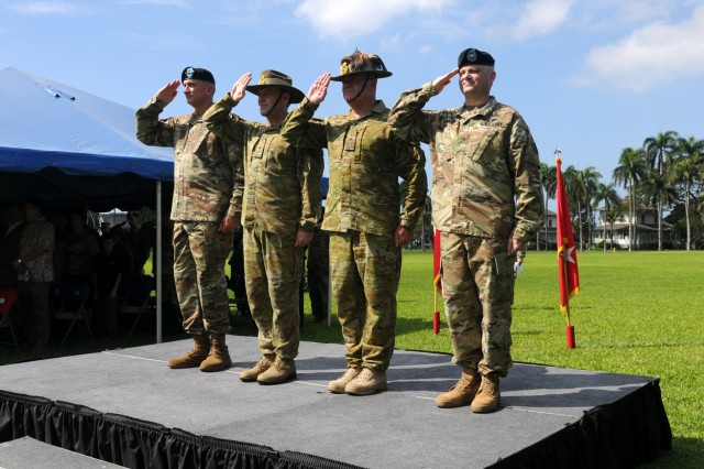 "U.S. Army Pacific Commanding General, Gen. Robert B. Brown (left); Australian Army Maj. Gen. Gregory C. Bilton (second from left), outgoing Deputy Commanding General-North, U.S. Army Pacific; Australian Army Maj. Gen. Roger Noble (second from right), incoming Deputy Commanding General-North; and Brig. Gen. Doug Anderson (right), incoming Deputy Commanding General-Army Reserve, salute the American flag during the playing of the national anthem at a Flying ""V"" ceremony held at historic Palm Circle, Fort Shafter, Hawaii, March 14. The Flying ""V"" ceremony was held to honor Australian Army Maj. Gen. Gregory C. Bilton, outgoing Deputy Commanding General-North, U.S. Army Pacific, for his distinguished service as he prepares to depart USARPAC; and to welcome Australian Army Maj. Gen. Roger Noble, incoming Deputy Commanding General-North; and U.S. Army Brig. Gen. Doug Anderson, incoming Deputy Commanding General-Army Reserve. The ""V"" refers to the way the colors are posted during the ceremony, which is V-shaped. (U.S. Army photo by Staff Sgt. Chris McCullough, U.S. Army Pacific Public Affairs)"