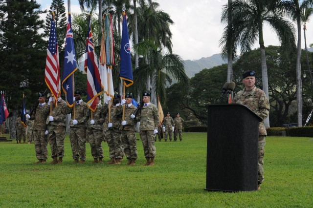 "Brig. Gen. Doug Anderson (right), incoming Deputy Commanding General-Army Reserve, USARPAC, delivers his speech during at a Flying ""V"" ceremony held at historic Palm Circle, Fort Shafter, Hawaii, March 14. The Flying ""V"" ceremony was held to honor Anderson in his new role, as well as Australian Army Maj. Gen. Gregory C. Bilton (not pictured), outgoing Deputy Commanding General-North, U.S. Army Pacific, for his distinguished service as he prepares to depart USARPAC; and to welcome Australian Army Maj. Gen. Roger Noble (not pictured), incoming Deputy Commanding General-North. The ""V"" refers to the way the colors are posted during the ceremony, which is V-shaped. (U.S. Army photo by Staff Sgt. Chris McCullough, U.S. Army Pacific Public Affairs)"