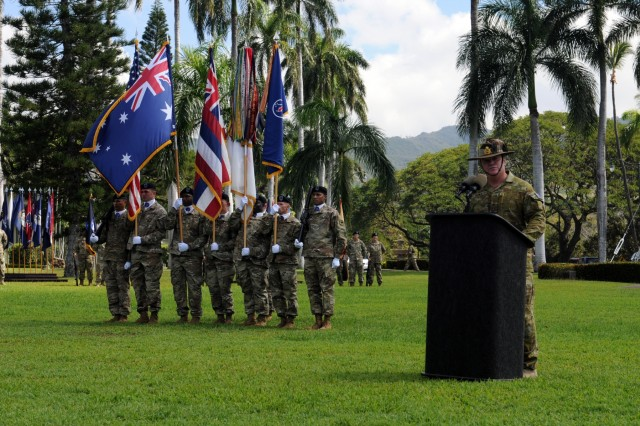 "Australian Army Maj. Gen. Roger Noble (right), incoming Deputy Commanding General-North, USARPAC, delivers his speech during at a Flying ""V"" ceremony held at historic Palm Circle, Fort Shafter, Hawaii, March 14. The Flying ""V"" ceremony was held to honor Noble in his new role, as well as Australian Army Maj. Gen. Gregory C. Bilton (not pictured), outgoing Deputy Commanding General-North, U.S. Army Pacific, for his distinguished service as he prepares to depart USARPAC; and to welcome Brig. Gen. Doug Anderson (not pictured), incoming Deputy Commanding General-Army Reserve. The ""V"" refers to the way the colors are posted during the ceremony, which is V-shaped. (U.S. Army photo by Staff Sgt. Chris McCullough, U.S. Army Pacific Public Affairs)"