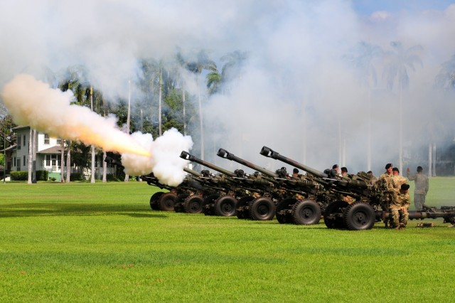 "Alpha Battery, 3-7 Field Artillery, 25th Infantry Division, fires its ceremonial cannons during a Flying ""V"" ceremony held at historic Palm Circle, Fort Shafter, Hawaii, March 14. The Flying ""V"" ceremony was held to honor Australian Army Maj. Gen. Gregory C. Bilton, outgoing Deputy Commanding General-North, U.S. Army Pacific, for his distinguished service as he prepares to depart USARPAC; and to welcome Australian Army Maj. Gen. Roger Noble, incoming Deputy Commanding General-North; and U.S. Army Brig. Gen. Doug Anderson, incoming Deputy Commanding General-Army Reserve. The ""V"" refers to the way the colors are posted during the ceremony, which is V-shaped. (U.S. Army photo by Staff Sgt. Michael Behlin, 8th Theater Sustainment Command Public Affairs)"