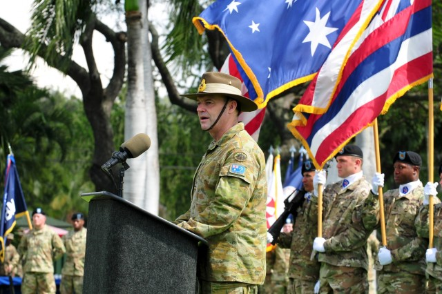 "Australian Army Maj. Gen. Gregory C. Bilton, outgoing Deputy Commanding General-North, U.S. Army Pacific, delivers his speech during at a Flying ""V"" ceremony held at historic Palm Circle, Fort Shafter, Hawaii, March 14. The Flying ""V"" ceremony was held to honor Bilton for his distinguished service as Deputy Commanding General-North, U.S. Army Pacific, as he prepares to depart USARPAC; and to welcome Brig. Gen. Doug Anderson (not pictured), incoming Deputy Commanding General-Army Reserve. The ""V"" refers to the way the colors are posted during the ceremony, which is V-shaped. (U.S. Army photo by Staff Sgt. Michael Behlin, 8th Theater Sustainment Command Public Affairs)"
