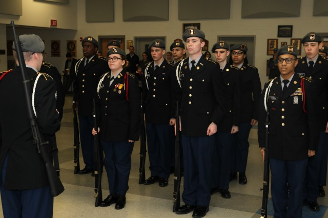 Cadets from Eastern High School, Louisville, Kentucky, prepare for the armed platoon inspection during the Sgt. Maj. Paul C. Gray JROTC Memorial Invitational Drill, Marksmanship and Academic Championships held in Radcliff, Kentucky March 11-12.
