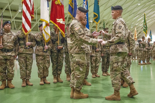 Command Sgt. Maj. Jon Stanley accepts the noncommissioned officer sword from Maj. Gen. Kent Savre, Maneuver Support Center of Excellence and Fort Leonard Wood commanding general, during his assumption of responsibility ceremony Friday.