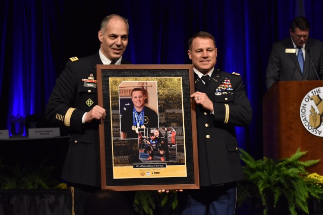 Gen. Gus Perna, left, commander of the Army Materiel Command, recognizes Maj. Donald Bigham, a powerlifter, as the Army's 2016 Male Athlete of the Year.