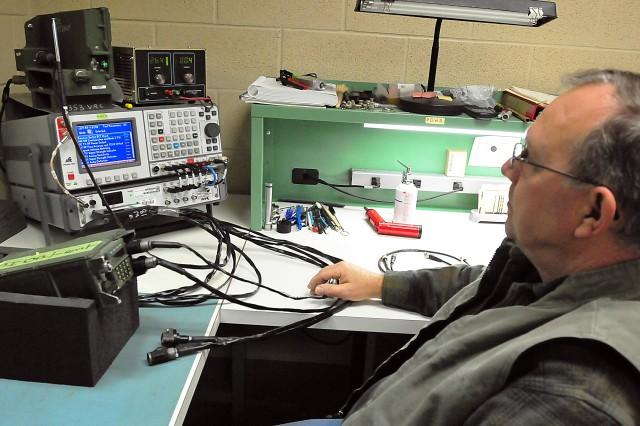 This technician in the Communications/Electronics and Armament section at LRC-Drum works on a SINCGARS ASIP manpack radio. The acronyms stand for Single Channel Ground and Airborne Radio System; Advanced System Improvement Program. (Photo by Jon Micheal Connor, ASC Public Affairs)