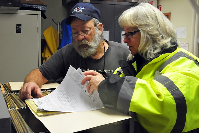 LRC-Drum employees of the Motor Transport Management Section, Transportation Division, check paperwork. (Photo by Jon Micheal Connor, ASC Public Affairs)