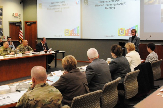 Rhonda VaDeCasteele, Executive Director for Ammunition, Munitions and Logistics Readiness Center, welcomes attendees to the two-day RAMP meeting at the Rock Island Arsenal, March 14.