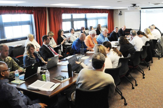 Attendees discuss ammo production and demilitarization issues concerning Crane Army Ammunition Activity and Letterkenny Munitions Center, during the RAMP meeting breakout session, March 15.