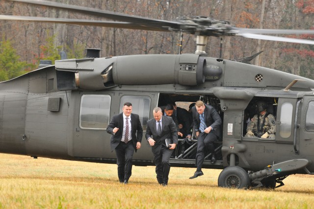 Members of the U.S. Army's Protective Services Battalion exit a UH-60 at a landing zone on Marine Corps Base Quantico, Va., during a weeklong training evolution Nov. 29, 2016.