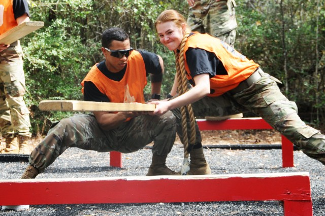 Soldiers work through an obstacle at the Leaders Reaction Course March 11.