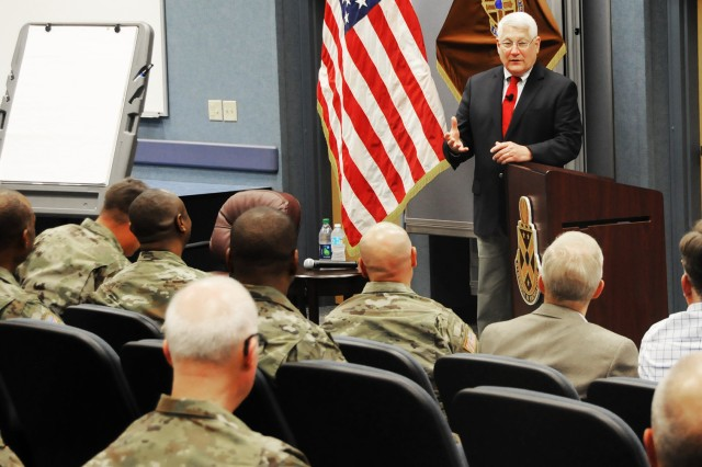 Retired Gen. Carter F. Ham, Association of the U.S. Army president and chief executive officer, speaks with senior warrant officers on ethics and leader development during a visit to the Warrant Officer Career College March 8.