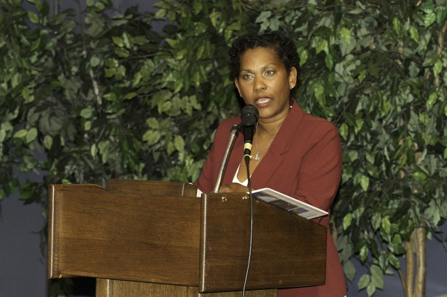 Retired Col. Kirsten Brunson speaks to the audience March 8 during the Women's History Month observance at the Commons. A former JAG officer and the first African American female to serve as an Army judge, Brunson spoke of the importance of creating one's own definition of success.