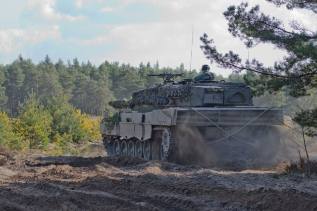 A Polish Leopard 2A4 main battle tank leaves its battle position to begin the combined maneuver training at Range Joanna in Karliki, Poland March 15, 2017. Operation Atlantic Resolve provides the opportunity to hone skills and sustain the ability to shoot, move and communicate alongside NATO Allies.