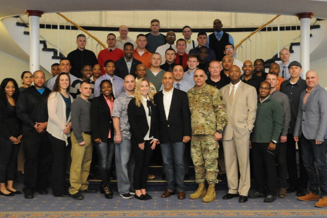 "Kaiserslautern, Germany -- Attending NCO's from across the 21st Theater Sustainment Command's footprint stand together in honor of completely the 3 day ""Not in My Squad"" Army directed initiative workshop. March 17, 2017 at the Armstrong Club, location on the Vogelweh Housing Complex. Participates engaged in several breakout session to development their leadership skills and abilities. (U.S. Army photo by Brittany Jones, 21st TSC Public Affairs)"