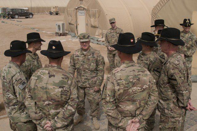 Maj. Gen. Blake Ortner, commanding general of the 29th Infantry Division, speaks with the battalion commanders of the 3rd Armored Brigade Combat Team, 1st Cavalry Division, prior to the start of a transfer of authority ceremony at Camp Buehring, Kuwait, March 12. The 3rd Armored Brigade Combat Team, 1st Armored Division relinquished control of the partnership and security cooperation mission here to the 3rd ABCT, 1st Cav. Div. (U.S. Army photo by Staff Sgt. Leah R. Kilpatrick, 3rd Armored Brigade Combat Team Public Affairs Office, 1st Cavalry Division (released)