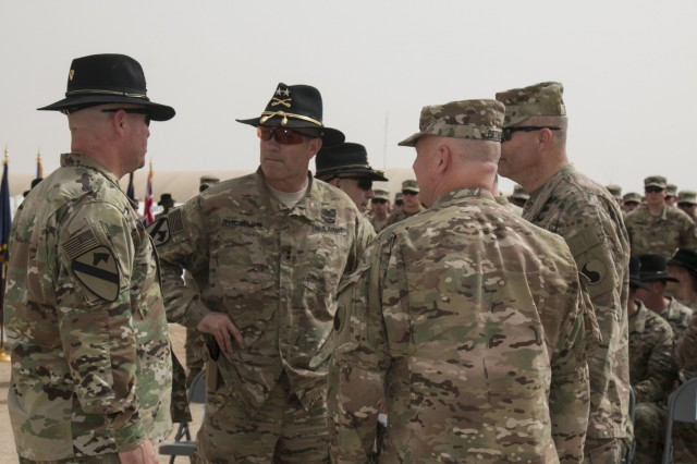 (From left to right) The commander of the 3rd Armored Brigade Combat Team, 1st Cavalry Division, Col. John Woodward speaks with 1st Cavalry Division commanding general Maj. Gen. John Thomson; Maj. Gen. Blake Ortner, commanding general of the 29th Infantry Division; and 29th ID deputy commanding general Brig. Gen. John Epperly prior to the start of a transfer of authority ceremony at Camp Buehring, Kuwait, March 12. The 3rd ABCT, 1st Cav. Div. assumed the mission from the 3rd Armored Brigade Combat Team, 1st Cavalry Division. (U.S. Army photo by Staff Sgt. Leah R. Kilpatrick, 3rd Armored Brigade Combat Team Public Affairs Office, 1st Cavalry Division (released)