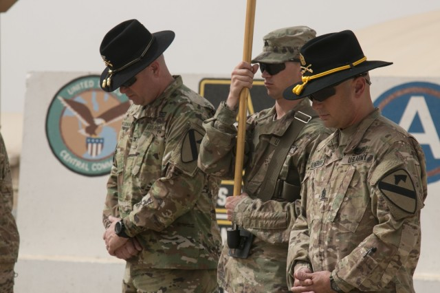 (From left to right) Col. John Woodward, commander of the 3rd Armored Brigade Combat Team, 1st Cavalry Division; Sgt. Devin Gill, command driver; and Command Sgt. Maj. Alfred Ronneburg, brigade senior enlisted advisor, bow their heads during the invocation at a transfer of authority ceremony at Camp Buehring, Kuwait, March 12. After nine months, the 3rd Armored Brigade Combat Team, 1st Armored Division cased its colors and relinquished control of the mission to the 3rd ABCT, 1st Cav. Div. (U.S. Army photo by Staff Sgt. Leah R. Kilpatrick, 3rd Armored Brigade Combat Team Public Affairs Office, 1st Cav. Div. (released)