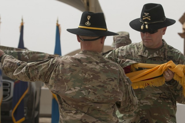 Col. John Woodward (right), commander of the 3rd Armored Brigade Combat Team, 1st Cavalry Division, and brigade senior enlisted advisor, Command Sgt. Maj. Alfred Ronneburg (left), uncase the unit colors during the transfer of authority ceremony at Camp Buehring, Kuwait, March 12. Simultaneously, the command team of the 3rd Armored Brigade Combat Team, 1st Armored Division cased their unit colors, signifying the transfer of authority for the mission. (U.S. Army photo by Staff Sgt. Leah R. Kilpatrick, 3rd Armored Brigade Combat Team Public Affairs Office, 1st Cav. Div. (released)