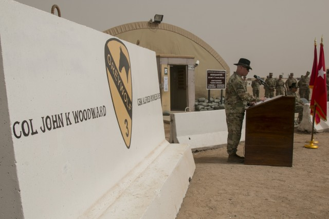 Col. John Woodward, commander of the 3rd Armored Brigade Combat Team, 1st Cavalry Division, addresses attendees at a transfer of authority ceremony at Camp Buehring, Kuwait, March 12. The 3rd Armored Brigade Combat Team, 1st Armored Division relinquished control of the partnership and security cooperation mission in the region to the 3rd Armored Brigade Combat Team, 1st Cavalry Division. (U.S. Army photo by Staff Sgt. Leah R. Kilpatrick, 3rd Armored Brigade Combat Team Public Affairs Office, 1st Cavalry Division (released)