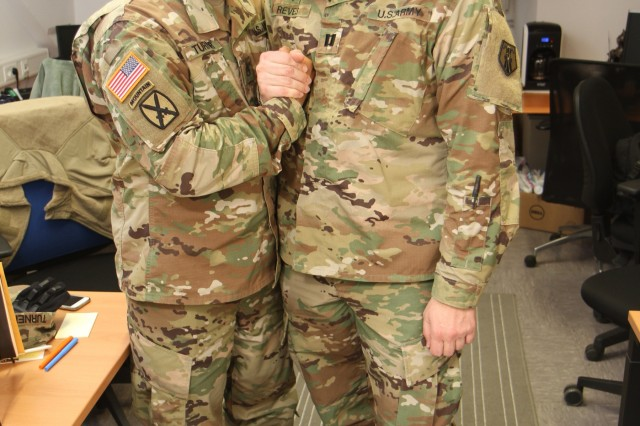 KAISERSLAUTERN, Germany-- Staff Sgt. Lamar Turner, chaplain's assistant, left, and Capt. Matthew P. Reves commander, both from the 89th Chaplain Detachment, 7th Mission Support Command pose for a photo March 19, 2017 as they prepare for deployment. (Photo by Sgt. Daniel J. Friedberg, 7th MSC Public Affairs Office)