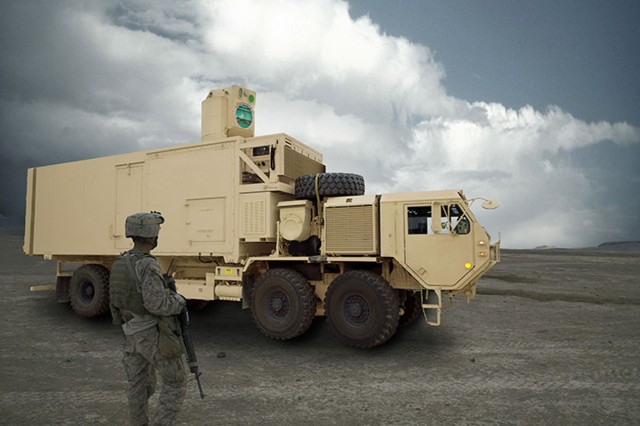 A Soldier stands next to a High Energy Laser Mobile Test Truck, which is planned to be integrated with a 60kW laser that successfully completed testing earlier in March. The laser was designed and built by Lockheed Martin, headquartered in Bothell, Washington, and was managed by USASMDC/ARSTRAT Technical Center's High Energy Laser Branch, headquartered at Redstone Arsenal.