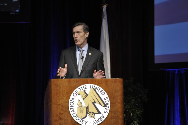 Karl Schneider, performing the duties of the Under Secretary of the Army, speaks March 14 about Army priorities and process reform at the Association of the U.S. Army's Global Force Symposium in at the Von Braun Center in Huntsville.