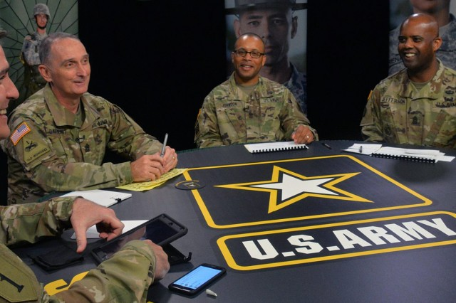 From left: moderator Master Sgt. Michael Lavigne, Command Sgt. Maj. David Davenport, U.S. Army Training and Doctrine Command's senior enlisted leader; Sgt. Maj. Derek Johnson, deputy chief of staff G-1 sergeant major at Headquarters Department of the Army, and Command Sgt. Maj. Wardell Jefferson, U.S. Army Human Resources Command's senior enlisted leader, prepare for TRADOC's third town hall on talent management Nov. 3, at Fort Eustis, Virginia. (Photo Credit: Martha C. Koester, NCO Journal)