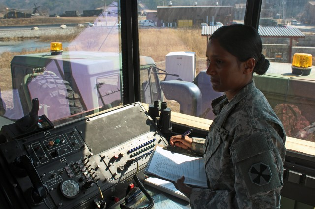 4-58th Airfield Operations Battalion Control Tower Operator Sgt. Vera N. Seurattan coordinates flight data for arriving aircraft in the tactical control tower.