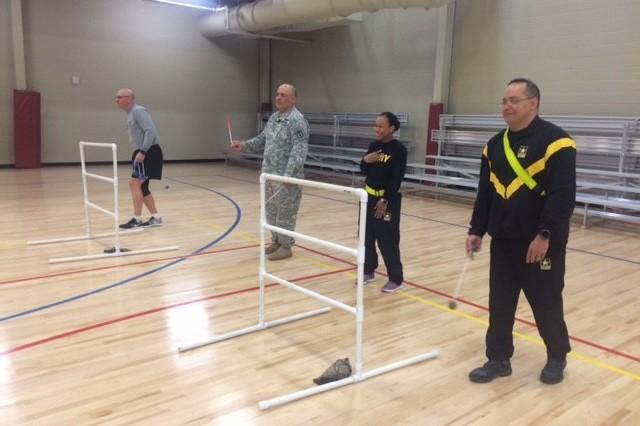 (L-R) Staff Sgt. Tim McNeil, Staff Sgt. Anthony Torres, Sgt. Tiffany Franklin and Capt. Alex Delgado gear up for Ladderball practice.