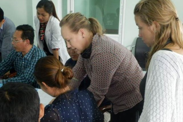 Lt. Col. Teresa M. Terry, the chief of Transfusion Medicine Service in Tripler's Department of Pathology, works with Cambodia medical staff to help prepare the Cambodia National Blood Transfusion Center for accreditation processes.