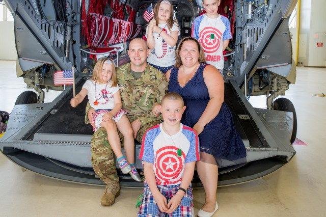 Rhiannon Knutson poses for a photo with her family on the back of a CH-47 Chinook helicopter. Knutson, who won the National Guard's military spouse of the year, and Cassaundra Martinez, who is representing the regular Army, are in the running with other branch winners to be called the 2017 Military Spouse of the Year. The winner, which was chosen by online voting earlier this month, will be announced May 12 at a ceremony in Washington, D.C.