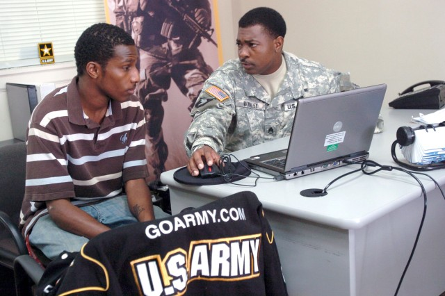Staff Sgt. Roger L. Whaley speaks with Phillip McDonald about the possibility of becoming a journalist or X-ray technician for the Army at the U.S. Army Recruiting Station in Radcliff, Kentucky.