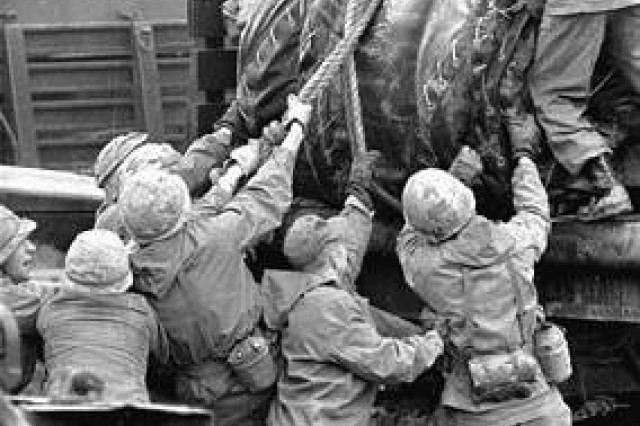 In 1968, Soldiers unload inflatable pontoons during a bridge-building exercise on the Main River southeast of Frankfurt, as part of REFORGER, one of U.S. Army Europe's largest and most memorable training events.