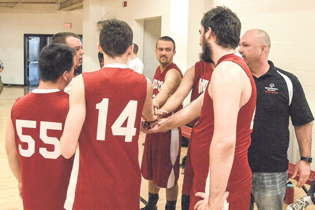 The Southeast Wolfpack Red team gets motivated before playing their final quarter against the Howell County Thunder on Saturday at Davidson Fitness Center.