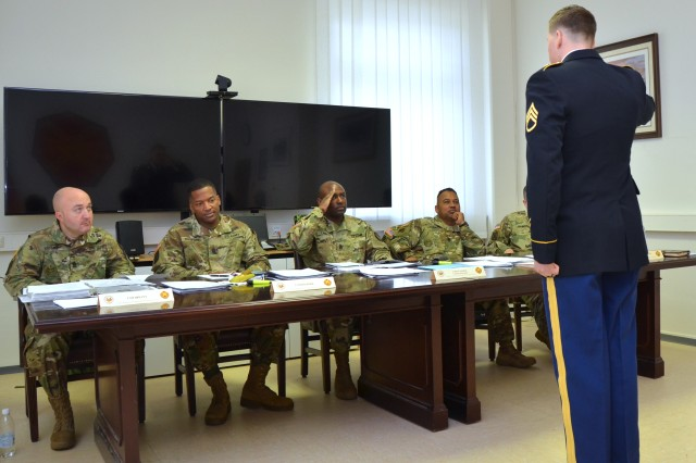 Staff Sgt. Brendan Hagens of U.S. Army Garrison Wiesbaden participates in an oral board on Day 1 of the 2017 Installation Management Command - Europe Best Warrior Competition at USAG Ansbach, Germany, March 20, 2017. Hagens won the title of Best Warrior in the noncommissioned officer category.